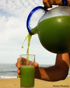 green juice poured into a glass, raw food eating