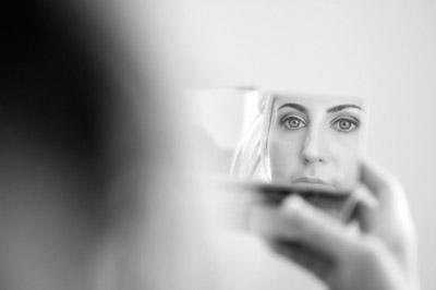 woman looking in mirror, it's all faked